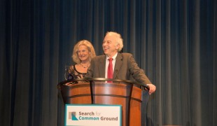 John and Susan Collin Marks take the podium to accept their award and look back on their lives as peacebuilders.