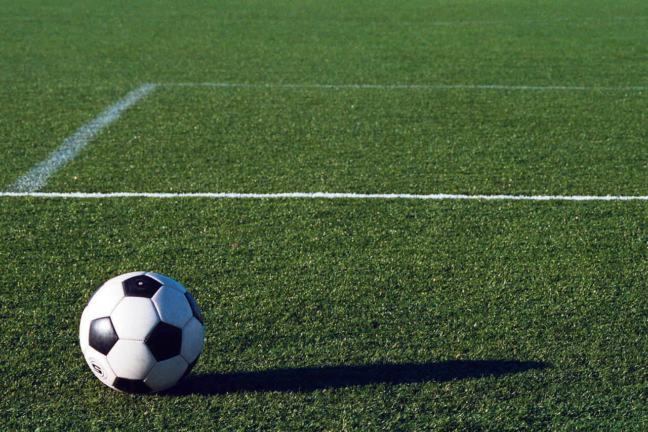 soccer ball on field | Search for Common Ground