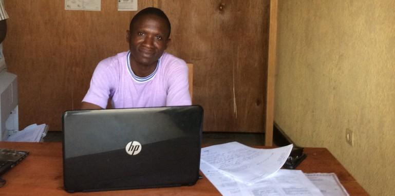 Augustin Nsengiymva in his cyber-café